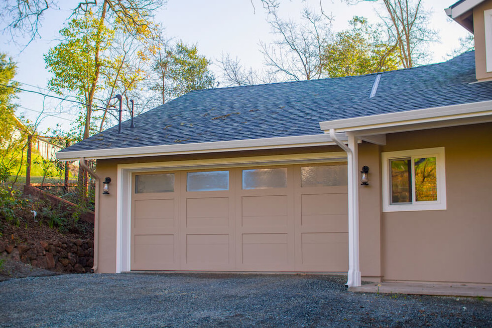 A newly constructed garage replaces the old carport.