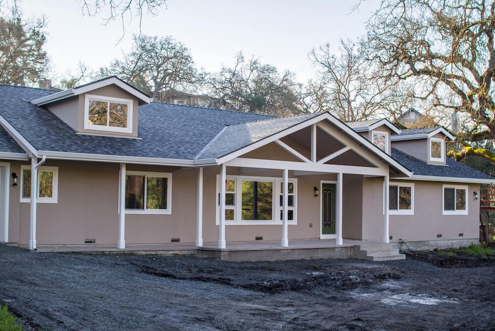The original house was a low-slung ranch that looked more like a classroom than a family home.  The entry was ill-defined, and the combined laundry bathroom was rotting away.  Our clients also needed a garage, so the existing carport wouldn't do.