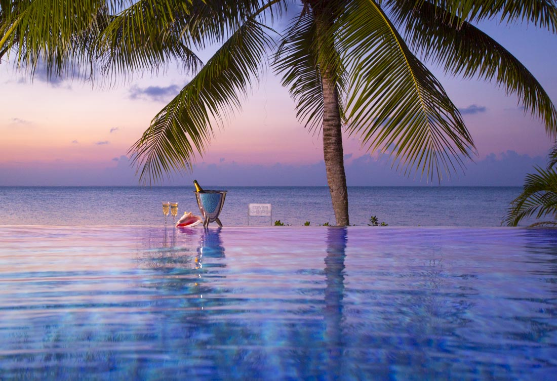 Sunset infinity edge Oasis Pools Cayman Islands