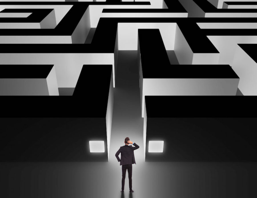 Image Of A Man About To Enter A Maze