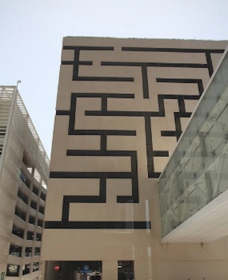 Image Of A Building With Maze Art On Its Side