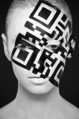 Image Of Person With Q-Code On Their Face