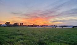 Sun setting on the horizon