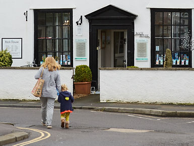 A mother and child visiting Rock House Dental Practice. Heathy teeth starts at a young age!