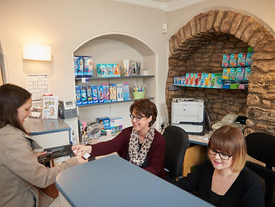 Our friendly front desk staff greet our patients with a smile.