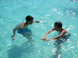 Learning to teach others to swim