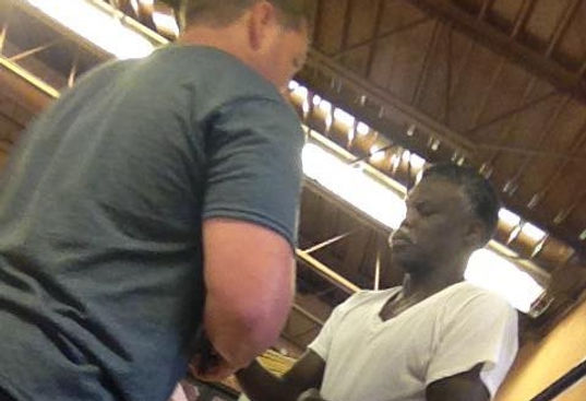 Andy praying with a man to recieve Jesus as his Savior.