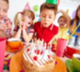 kids-blowing-candles-on-birthday-party_1