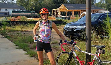 Americus train and cyclist.JPG