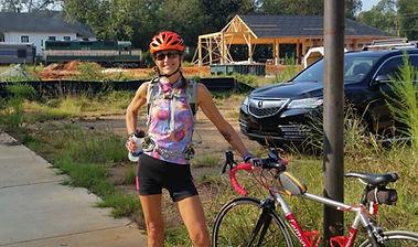 Americus train and cyclist.JPG