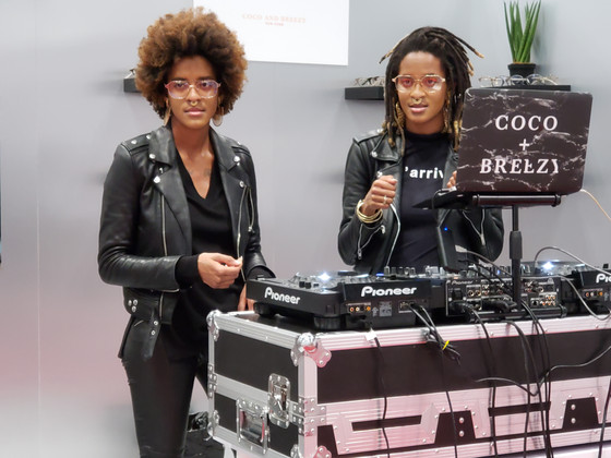 Coco and Breezy DJ and display at Vision Expo