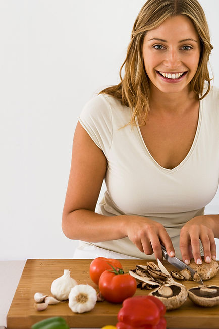 Woman Cutting Vegetables