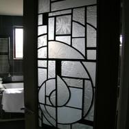 Textured glass panel in situ as bathroom door panel, private residence, Edinburgh, 2010