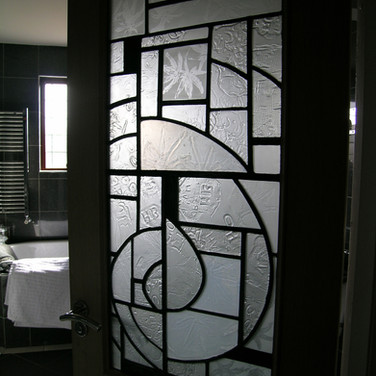 Textured glass panel in situ as bathroom door panel, private residence, Edinburgh, 2010