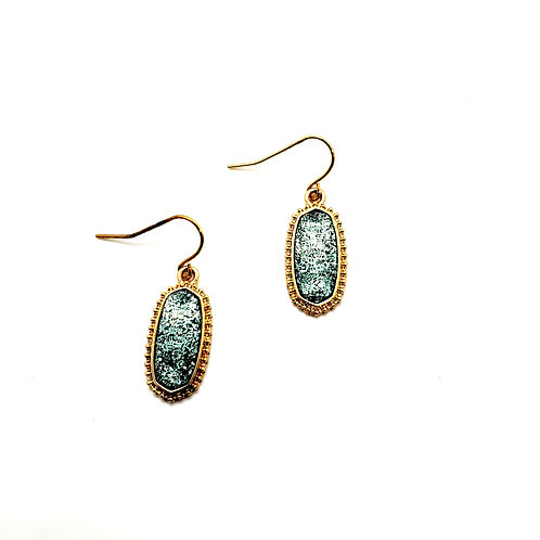 The Oval Princess- in a delicate Gold Finish with an Icy Blue Drusy Center