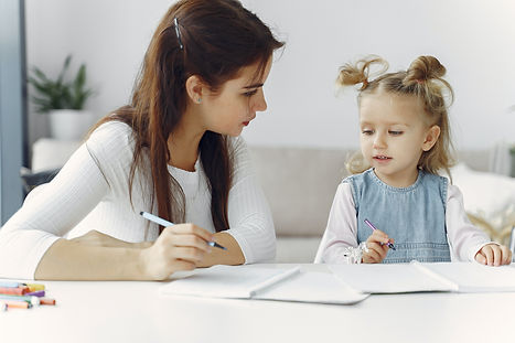 woman-teaching-little-kid-how-to-draw-39