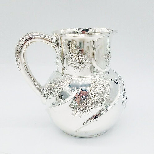 TIFFANY & CO. STERLING SILVER REPOUSSE PITCHER