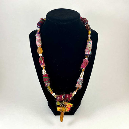 Bead, wire and cloth necklace