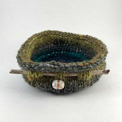 Green crochet basket by Lyn Harris