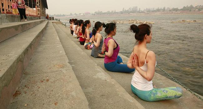 Yoga on the banks of river Ganga