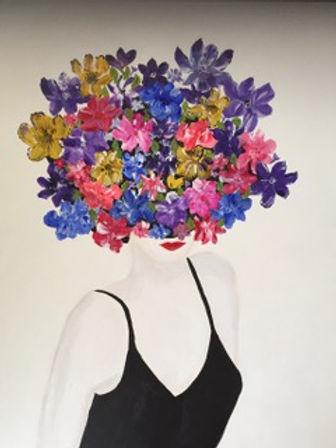 Diane Woods Flowers in her Hair.jpeg Female torso dressed in black with large multi floral headpiece