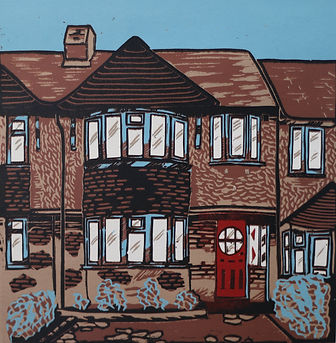 KimBlackshawHome terrace houses inin black and brown with blue and red detail to windows and door.