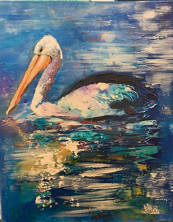 Di Weingott - Pelican.jpeg Pelican with reflected pink and aqua on wings on water
