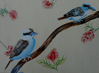 The Earlier Bird.jpg two kookarurras, one with worm with red grevilleas.
