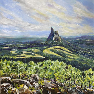 sue Burton Glasshouse Mountains. Predominantly green landscape with cloudy sky and prominant mountain .