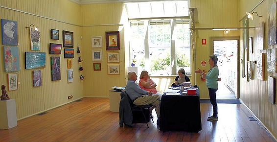 wide angle view of gallery with four people