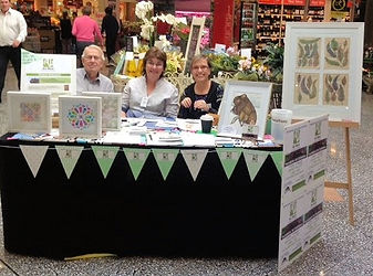 Art and Membership stall in shopping centre