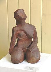clay sculpture female kneeling