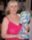 woman holding 3D art work