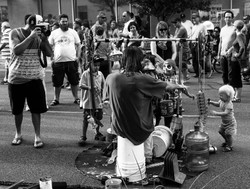 one man band and helpers