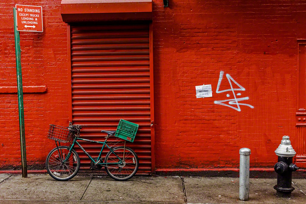 green bike red wall