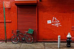 green bike red wall