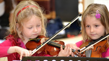 At what age should children start taking music lessons?