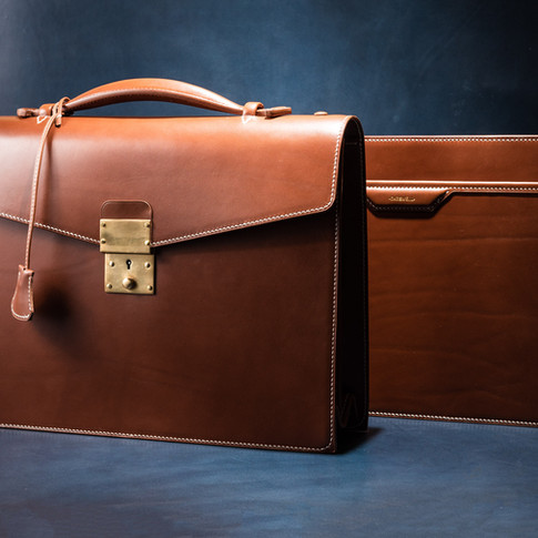 Briefcase and matching zippered folio.