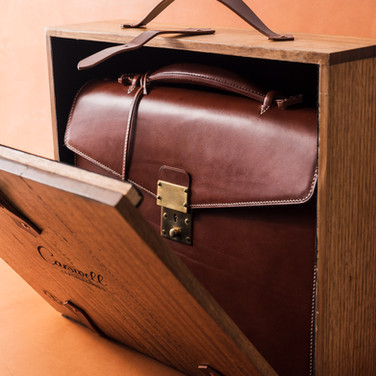A solid timber presentation box made with Tasmanian Oak and fully lined with black suede. The handles are made from the same leather as the briefcase.