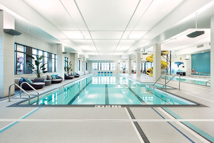 Swimming Pool, activity Pool, The Village Center, Westman Village, Yllow Super Squirt Waterslide, Stainless Steel railings, ADA Ramp, White Tile Pool Basin, Lane Swim Tile stripes Jay Westman, Constructed By Serenity Pools