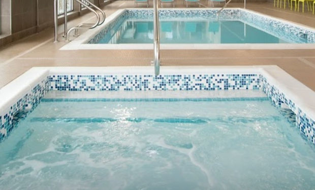 """Swimming Pool Holiday Inn Express & Suites, Spa. Porcelain 1""""x 1"""" Random Blue, Teal, White Tile, White Tiled Pool Basin, Stainless Steel Handrail, Inlays TIle, Depth Markers, Pool Nosing"""