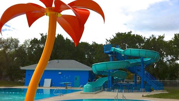 Teal Waterslide, Blue Steel Stairs, Swimming pool, Water Spray Featrure, Palm Tree, Stainless Steel Rails, Saskatoon Mayfair Outdoor Pool