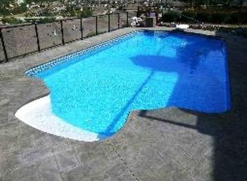 Vinyl Liner Pool, Roman Shape, Rock Walls, Stamped Concrete, Residential Swimming Pool