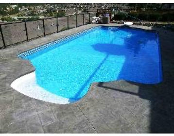 Vinyl liner pool, Blue Liner, Charcoal Stamped Concrete, White Pool Stairs, Black chain link fence