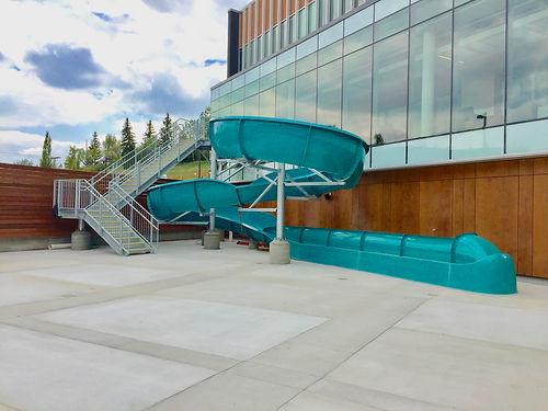 Glencoe Club Waterslide.jpeg, Calgary Glencoe Club, Galvanized Steel Stairs, Green Waterslide, Runout Lane, Concrete Pool Deck, Whitewater West Industries Ltd.