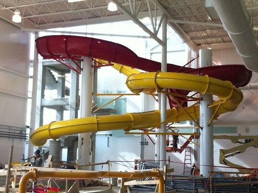 Battlefords CO-OP Aquatic Facility, CuPlex Aquatic Center, Red Waterslide, Yellow Waterslide, White Concrete Columns, Concrete Waterslide Tower, Whitewater West Industries Ltd., Suspended Concrete,