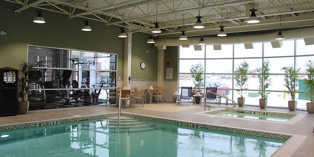 """Swimming Pool Holiday Inn Express & Suites, Spa. Glass 1""""x 1"""" Tile, White Tiled Pool, Stainless Steel Handrail, Inlays TIle, Depth Markers, Pool Nosing"""