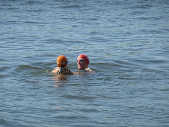 coach and nervous swimmer in open water