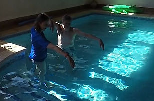 Standing rehearsal in pool of a swimming position