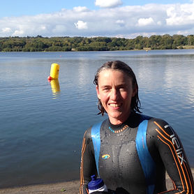 Photo of Marianne, the swim coach, in her wetsuit at WeirWood Reservoir